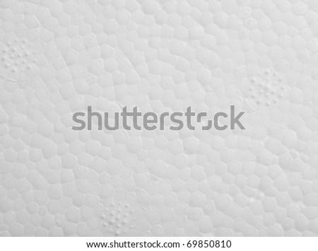 white polystyrene protection texture, extreme closeup photo