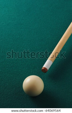white pool balls with stick
