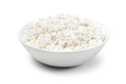 white porcelain bowl with grainy cottage cheese isolated on a white background