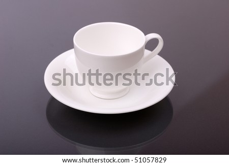 White porcelain cup on a grey background