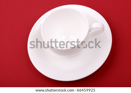 White porcelain cup on a red background