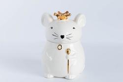 White porcelain rat princess in a golden crown.