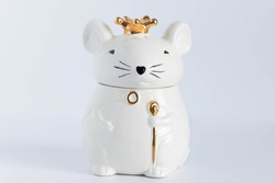 White porcelain rat princess in a golden crown