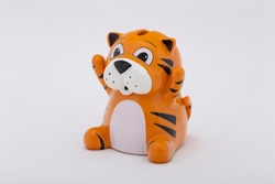 white porcelain tigress with a cub on white background