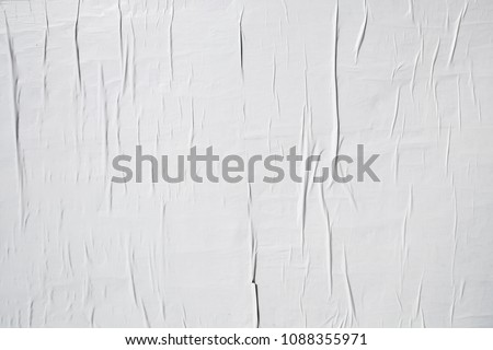 white poster layer glued with wallpaper paste