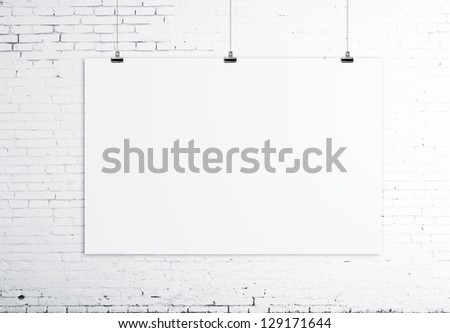 white poster on brick wall