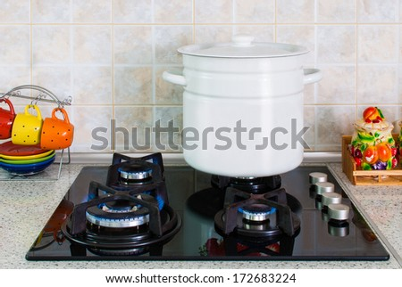 white pot on a gas stove delivered in the kitchen