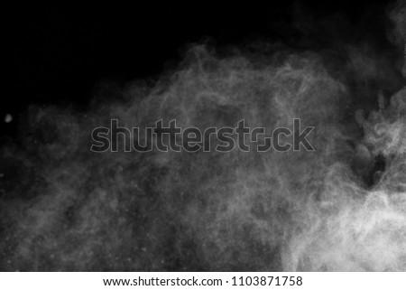 White Powder explosion on black background. White dust exploding. #1103871758