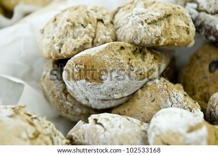 White powdered bagels and other assortments of bagels.