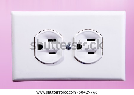 White power plug in a pink wall