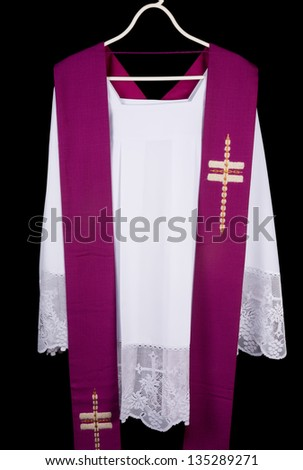 White priest surplice and purple stole as worn during confession and mass