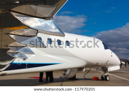 white  private  jet and wing with chrome elements