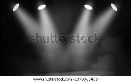 White projector. Spotlight stage with smoke on black background.Design element. #1370965436