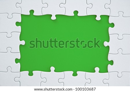 White Puzzle Frame on green Background