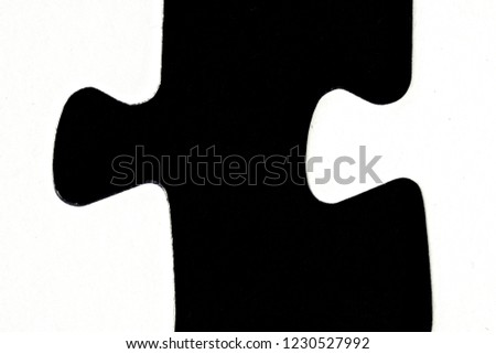 White puzzle pieces against a black background with a certain distance between the individual parts - concept for sub-steps or sub-elements of a large whole presented with puzzle pieces #1230527992