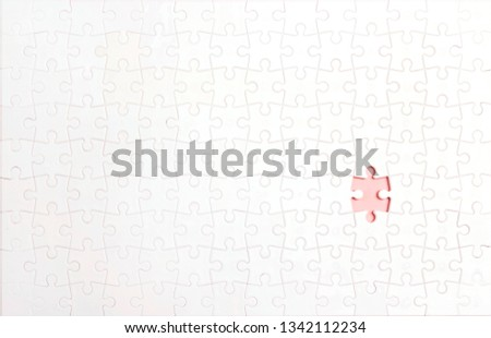White puzzle pieces with one lost piece. Copy space, top view.