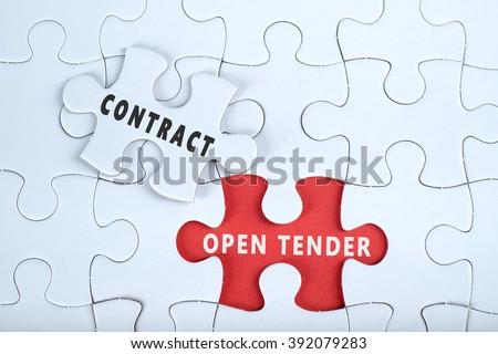 White puzzle with the word CONTRACT & OPEN TENDER, contract management conceptual