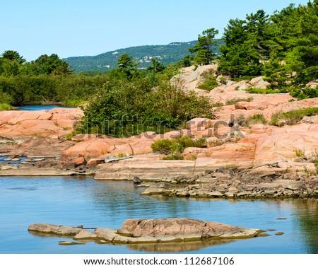 White quartzite mountains and pink granite rocks near Killarney, Ontario