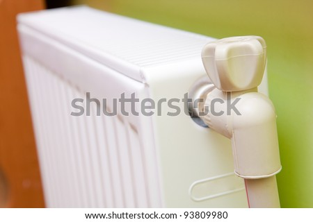 White radiator with radiator thermostat at home.