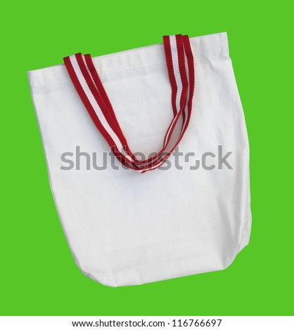 White raw cotton bag with color handle on green screen isolated background path included.