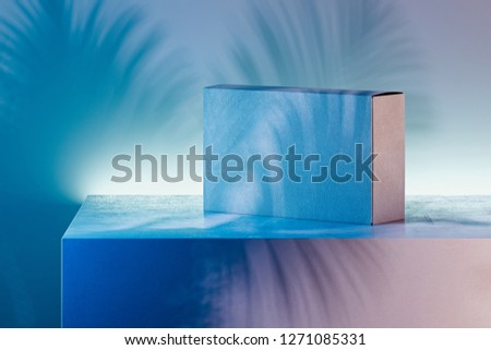 White realistic cardboard box on multicoloured background. 3d rendering.