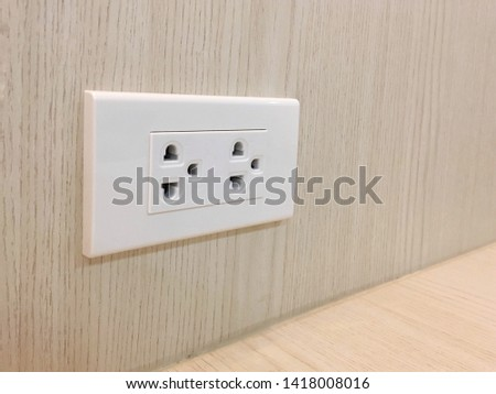 White receptacle or electrical outlet on wood wall. #1418008016
