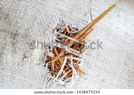 white receptacle with straw, leaky bag #1438479194