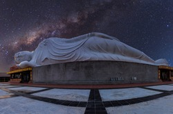 White reclining  buddha under starry night with clearly  milky way  , Thailand