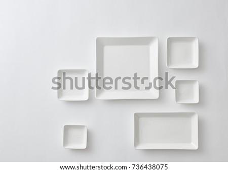 White rectangular plate on white background.