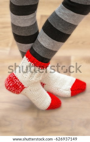 White red woolen socks on legs #626937149
