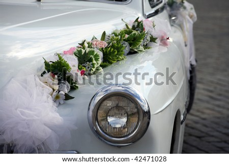 White retro car with flowers