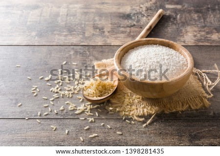 White rice flour in a bowl on wooden table. Copyspace #1398281435