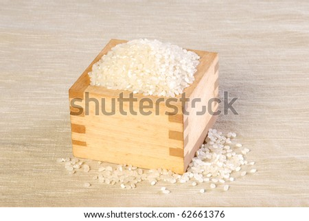 White rice in a cup of wooden - stock photo