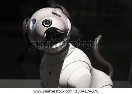 white robot dog smiling.