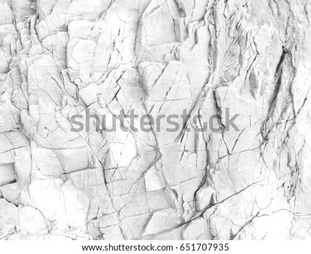 White rock wall. White background or texture.