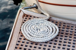 White rolled line for maritime mooring on gangway.