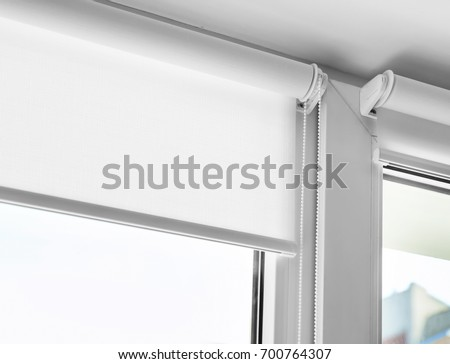 White roller blind on a metal plastic window