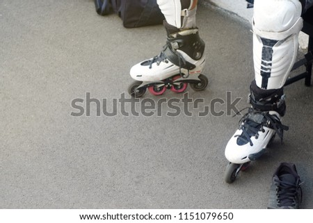 White rollers for riding with protection for knees for playing polo, the theme of sports and recreation  #1151079650