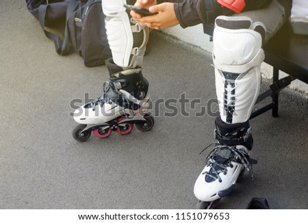 White rollers for riding with protection for knees for playing polo, the theme of sports and recreation  #1151079653