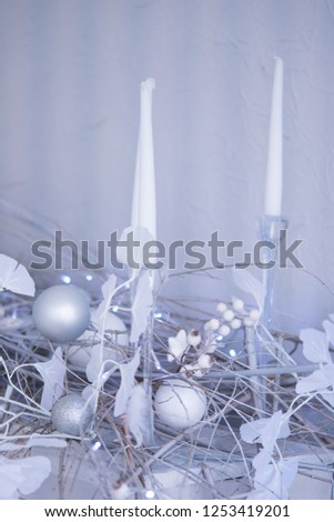 White room christmas interior decor with hand-made candle and bouq