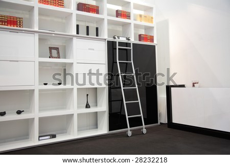 white room with book cabinet