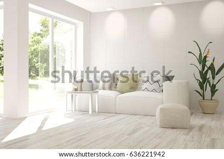 white room with sofa and green...