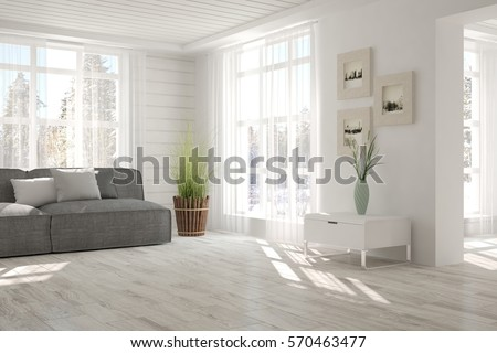 white room with sofa and winter ...