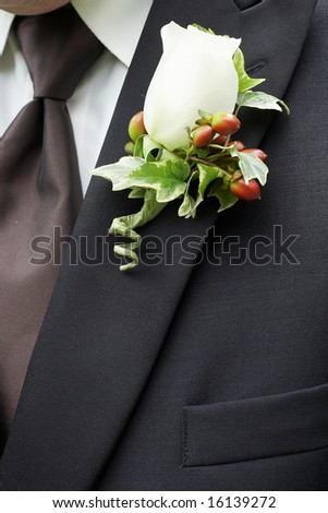 White Rose Wedding Boutonniere On Suit of Groom