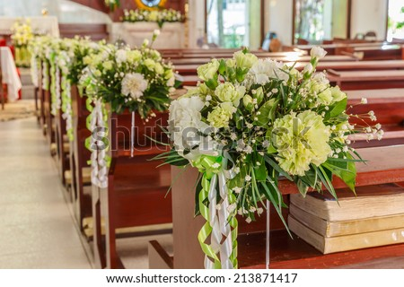 white roses and carnations flower wedding decoration in a church