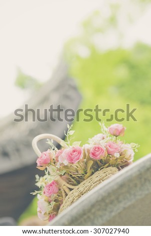 white roses background, shallow depth of field. Retro vintage instagram filter for background and text.