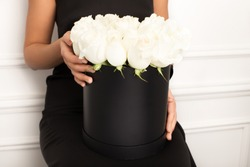 White Roses Bouquet in Woman's Hands