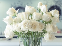 White roses Flower Arrangement in a glass vase