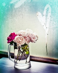 White roses in a glass vase with heart/ Valentines day romantic background