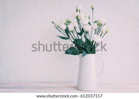 White roses in jar  #612037157